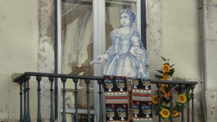 Lisbon # 10- Street scene with balcony figure