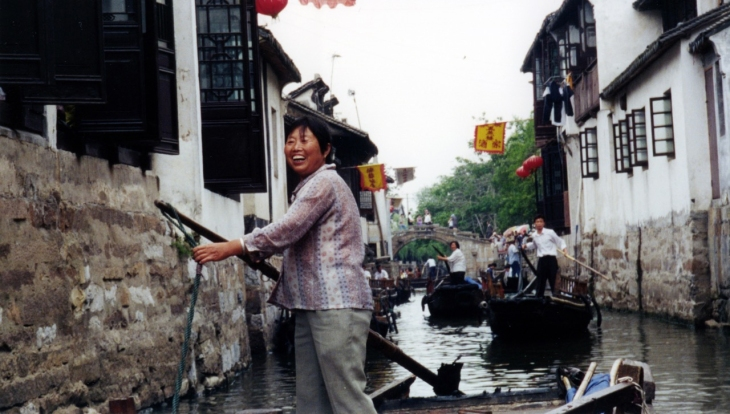 Many of the locations Rollins visits -- like this canal community in China -- become settings for his novels.